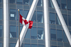 Canadian flag on calgary building Royalty Free Stock Image