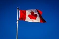 The Canadian Flag at Centre Island, in Toronto, Ontario. Stock Photos