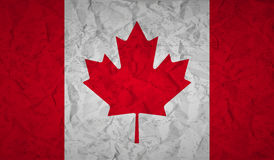 Canadian flag with the effect of crumpled paper and grunge Stock Images