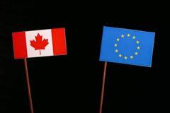 Canadian flag with European Union EU flag  on black. Background Royalty Free Stock Photos