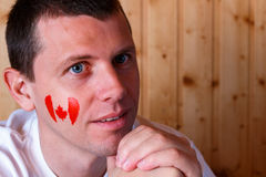Canadian flag on the face of young man Royalty Free Stock Image