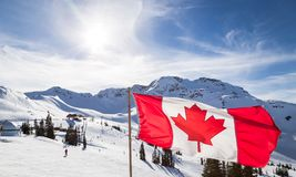 Canadian flag flying near the Rendezvous on top of Whistler Mountain. royalty free stock photo