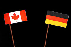 Canadian flag with German flag on black royalty free stock photos