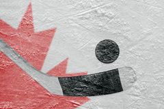 Canadian flag and hockey puck with a stick Stock Photo