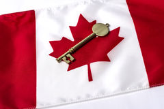 Canadian flag with Key. A key on top of a Canadian flag Royalty Free Stock Images