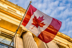 Canadian Flag. Canadian National Flag hanged in front of the Canadian Embassy in Travalgar Square in London, England Royalty Free Stock Images