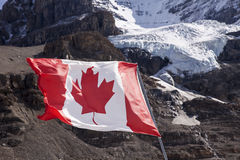 Canadian Flag Near Mount Andromeda Royalty Free Stock Photo