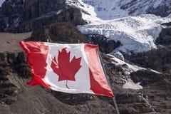 Canadian Flag Near Mount Andromeda Royalty Free Stock Photo