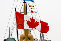Canadian Flag on Old Ship Stock Image