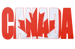 Canadian Flag in outline of word, Canada. Photo of the Canadian maple leaf red and flag within outline cutout of the word, Canada, on white background Stock Photos