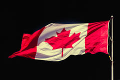 Canadian Flag over beautiful black, effect applied Stock Photo
