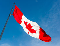 Canadian Flag over beautiful blue sky Stock Photography