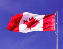 Canadian Flag over beautiful purple sky, effect ap Royalty Free Stock Photography
