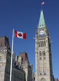 Canadian Flag and Parliament Stock Photo