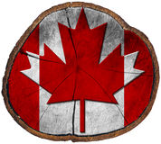 Canadian Flag on Section of Tree Trunk Royalty Free Stock Image