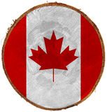 Canadian Flag on Section of Tree Trunk Royalty Free Stock Photo