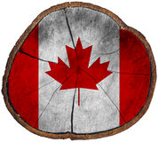 Canadian Flag on Section of Tree Trunk Royalty Free Stock Photos