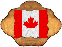 Canadian Flag on Section of Tree Trunk Stock Photo