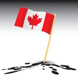 Canadian flag on splattered ground Stock Photo