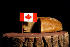 Canadian flag on a stump with bread royalty free stock photo