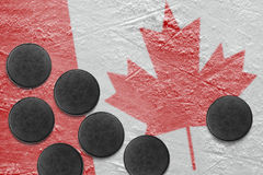 Canadian flag and washers on the ice Royalty Free Stock Images