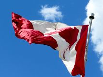 Thornhill Flag 2016. Canadian flag waving in the blue sky above the city Thornhill, Canada, May 17, 2016 Stock Photos
