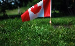 Canadian flag waving in the sky Stock Photo
