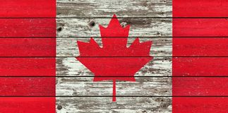 Canadian flag on a weathered rustic wood background. Canadian flag painted on a weathered rustic wood background Royalty Free Stock Images