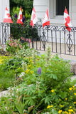 Canadian flags in front of white house Royalty Free Stock Photography