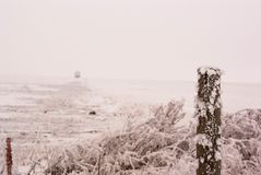Canadian Frosted Field With a Wooden Fence Pole royalty free stock images