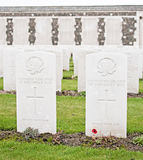 Canadian Graves At Tyne Cot. A grave to an unknown Canadian hero who fought and died at one of the battles of Passchendaele that were fought near the Belgian Royalty Free Stock Image
