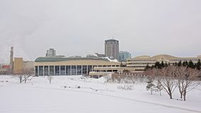 Canadian history museum on a cold winter day with snow. Modern architecture of the Canadian history museum in a park with bare and spruce trees on a cold winter stock image