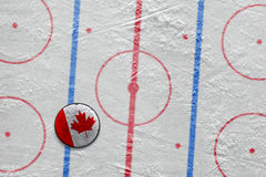 Canadian hockey puck on the site Stock Images