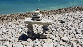Canadian Inukshuk. A pile of rocks sits on the edge of the Georgian Bay in Lions Head, Ontario Stock Images