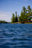 Canadian lake on sunny day Stock Images
