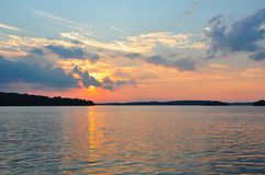 Canadian lake at sunset. Scenic view of a Canadian lake at sunset viewed from an island beach, Ontario, Canada Stock Photo