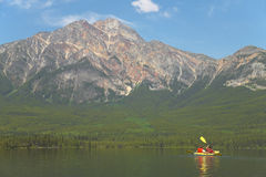 Canadian landscape with canoe in Pyramid lake. Alberta. Canada Stock Photo