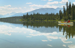 Canadian landscape with canoe in Pyramid lake. Alberta.  Stock Photo