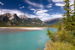 Canadian Landscape. Jasper National Park, Alberta. Beautiful canadian landscape with river, Rocky Mountains and cloudy sky taken on sunny day of autumn in Jasper Royalty Free Stock Images