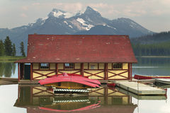 Canadian landscape with Maligne lake and canoes. Jasper. Alberta. Horizontal Stock Images