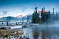 Canadian Landscape: Misty Sunrise at Pyramid Lake in Jasper, Alb Stock Photos