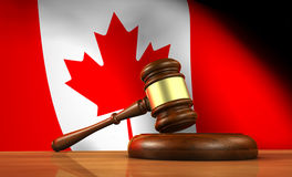Canadian Law And Justice Concept. Law and justice of Canada concept with a 3d rendering of a gavel on a wooden desktop and the Canadian flag on background