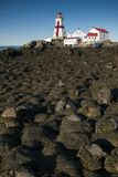 Canadian Lighthouse Surrounded by Rocks Covered in Seaweed During Low Tide Royalty Free Stock Photo