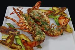 canadian lobster thermidor with asparagus and potato royalty free stock photos