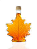 Canadian Maple Syrup Bottle. Leaf Shaped Canadian Glass Maple Syrup Bottle Isolated On A White Background With Reflection Royalty Free Stock Photography