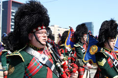 Canadian Marching Band Soldier. TORONTO, CANADA - APRIL 27: Marching band in the military parade in Toronto that marks the 200th anniversary of the Battle of Stock Image