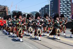 Canadian Marching Band. TORONTO, CANADA - APRIL 27: Marching band in the military parade in Toronto that marks the 200th anniversary of the Battle of York, which Royalty Free Stock Images