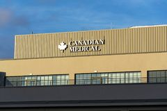 Canadian Medical company logo on headquarters building. PRAGUE, CZECH REPUBLIC - JANUARY 6: Canadian Medical company logo on headquarters building on January 6 royalty free stock images