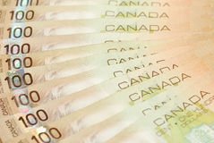 Canadian money. One hundred canadian bills background Stock Images