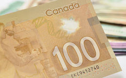 Canadian money. New one hundred canadian bills Royalty Free Stock Image